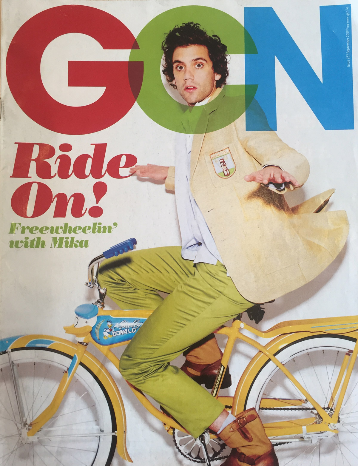 The 2009 Issue in the Evolution of GCN, Ireland's National LGBT Publication with Mika on the cover in lime green pants on a bicycle