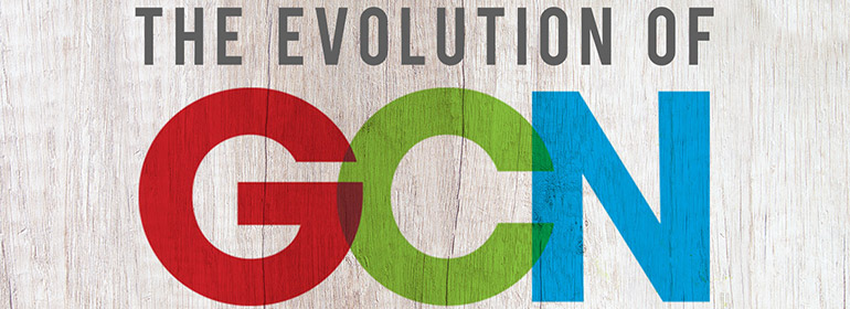 The Evolution of GCN, Gay Community News magazine written on a bleached wooden background
