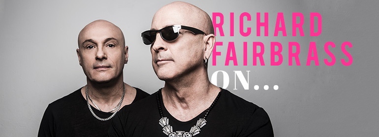 Richard Fairbrass and his brother Fred wearing black t-shirts, chains and sunglasses