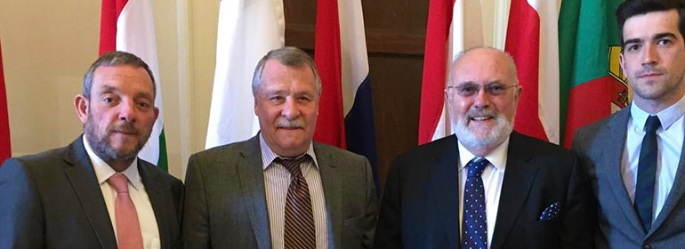 Irish politicians Senators David Norris, Fintan Warfield and Jerry Buttimer TD standing with the Russian Ambassador after discussing Chechnya and the country's gay purge