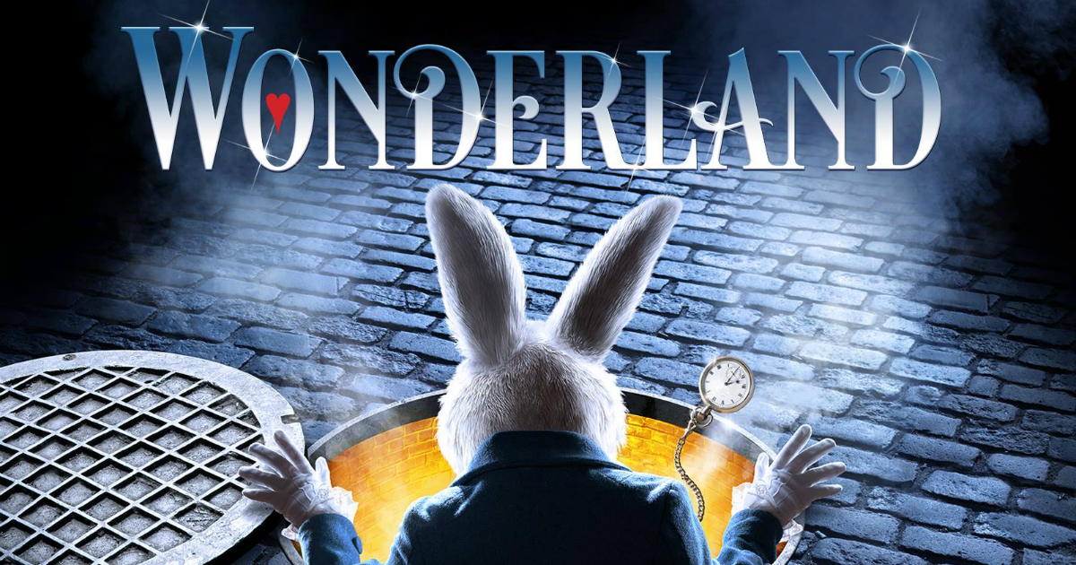 A poster for the show Wonderland at the Bord Gáis Energy Theatre with a white rabbit coming out of a yellow rabbit hole