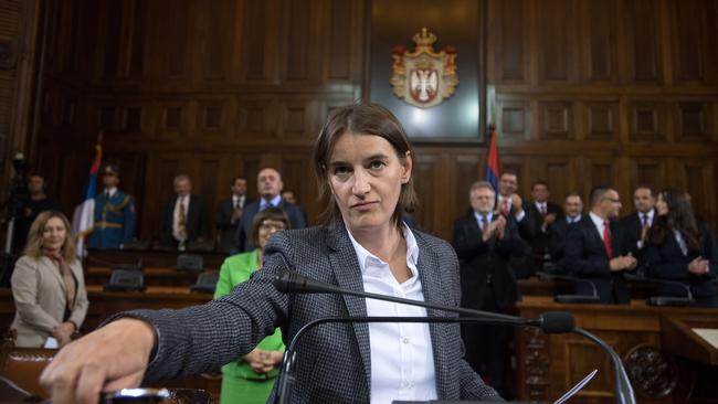Ana Brnabic standing in a court in a suit jacket