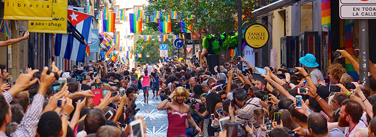 People celebrating World Pride in Madrid a place in Europe which faces hepatitis a outbreak in MSM this year