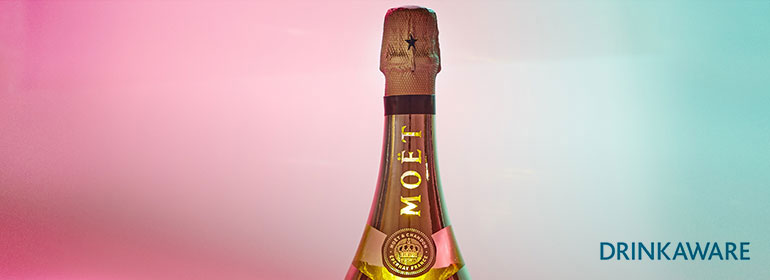 A bottle of moët against a pink and blue background to promote the moët party day 2017