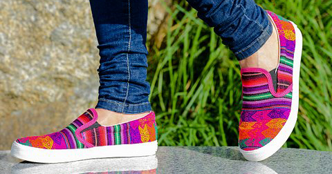 Close-up of colorful inkkas shoes, grass on the background