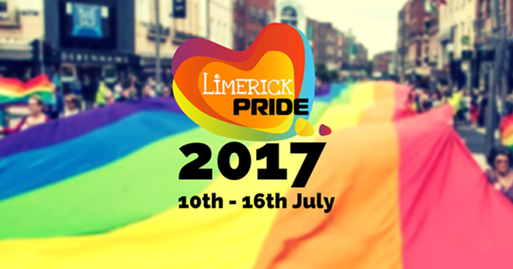 The Limerick Pride logo over the words 2017, 10th-16th July which are in front of a giant rainbow flag in Limerick