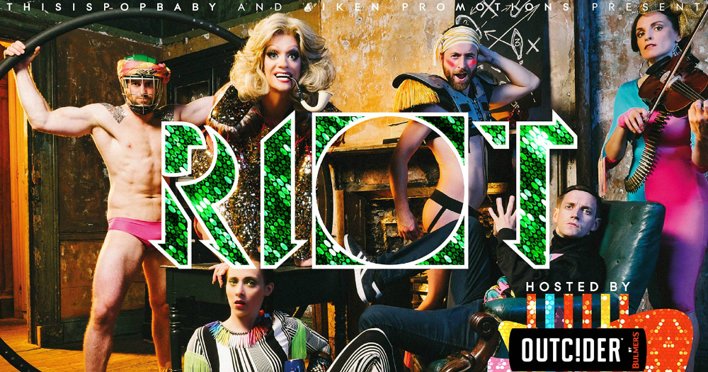 RIOT performers posing, RIOT logo in the centre of the poster, Outcider logo on bottom right