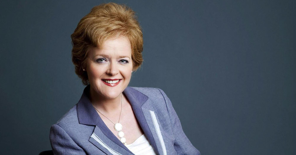 Ursula Halligan smiling in a lavender jacket