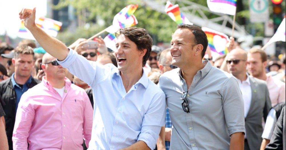 Justin Trudeau and Leo Varadkar smiling in shirts at Montreal Pride, the event which sparked the hashtag justinformleo