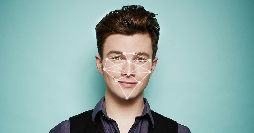 A picture of a gay person with dots and lines over their face which symbolise the artificial intelligence program that recognises facial structures that can determine if you are gay or straight