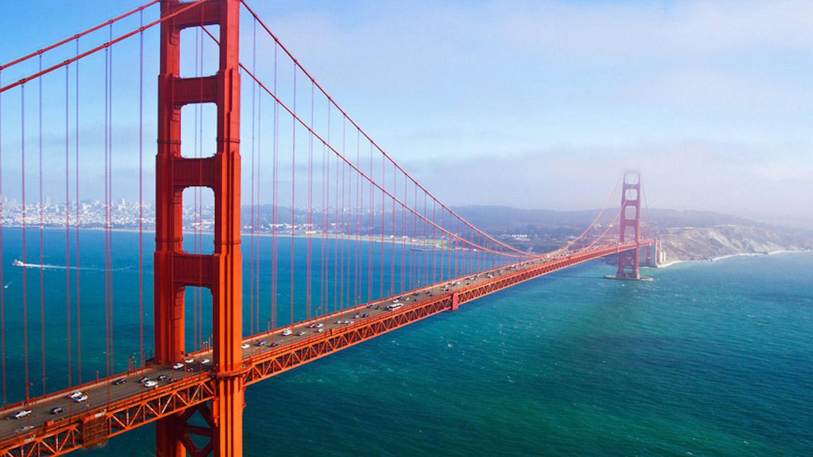 San fran golden gate bridge with blue water beneath it