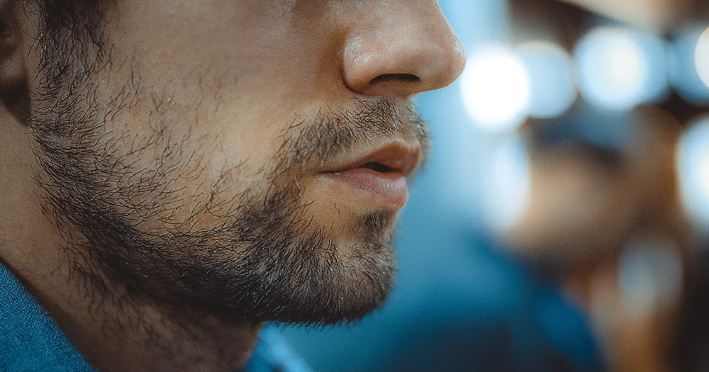 A picture of a man's jaw with a beard and a blue shirt on to symbolise the married men's support group