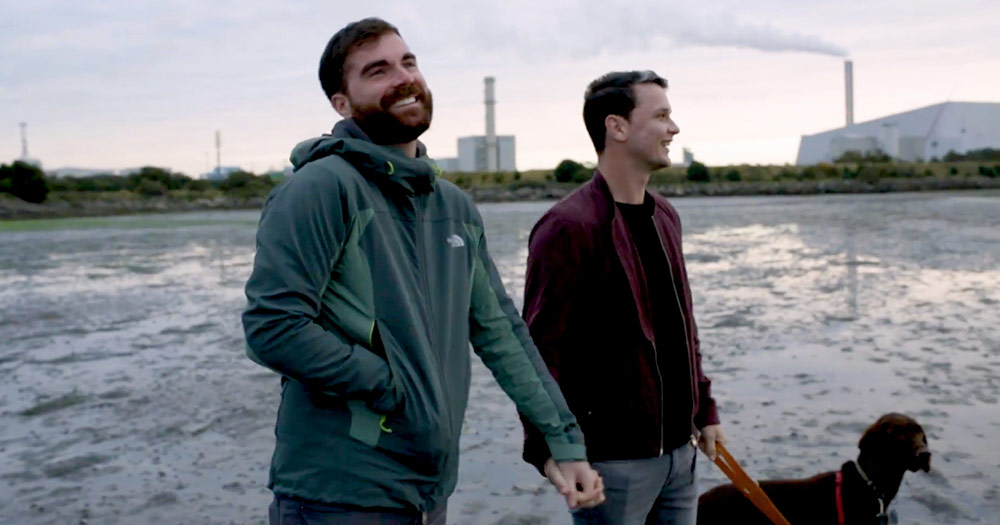 Maurice Leahy and Robbie Lawlor on a beach with their dog in the short film U=U for HIV activism group Act Up Dublin