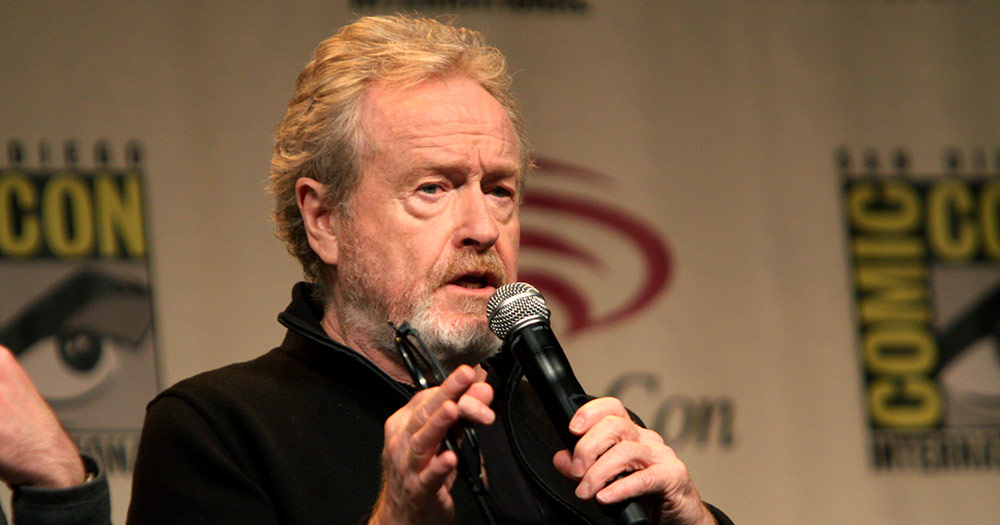 Ridley Scott holding a microphone and glasses in his hand because he's going to direct John Boyne's novel for TV 'The Heart's invisible furies'
