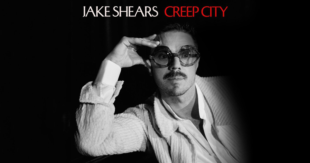Jake Shears posing in a chord shirt with big glasses for his new single creep city