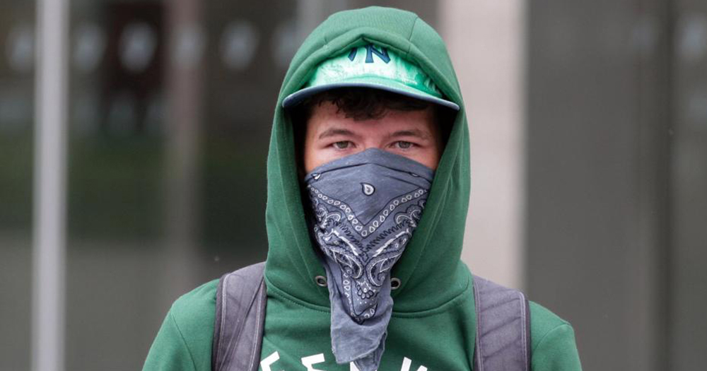 George Bar Vandal dressed in green has a bandana covering his face