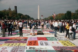 People Looking at the AIDS Quilt