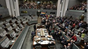 Photo of australian parliament during the members vote. The majority are sitting on the right side of the screen in favoour of the vote whilst four remain on the opposition bench.
