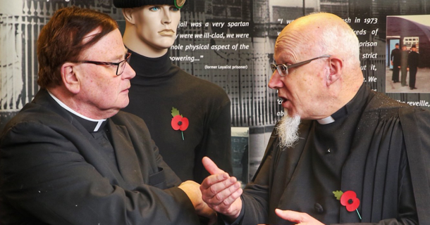 Two elderly priests discussing Church matters