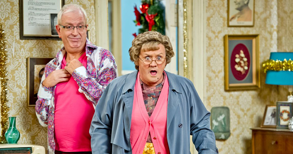 Rory and Brendan O'Carroll as Mrs Brown in the sitting room. Mrs Brown and Rory both looks shocked