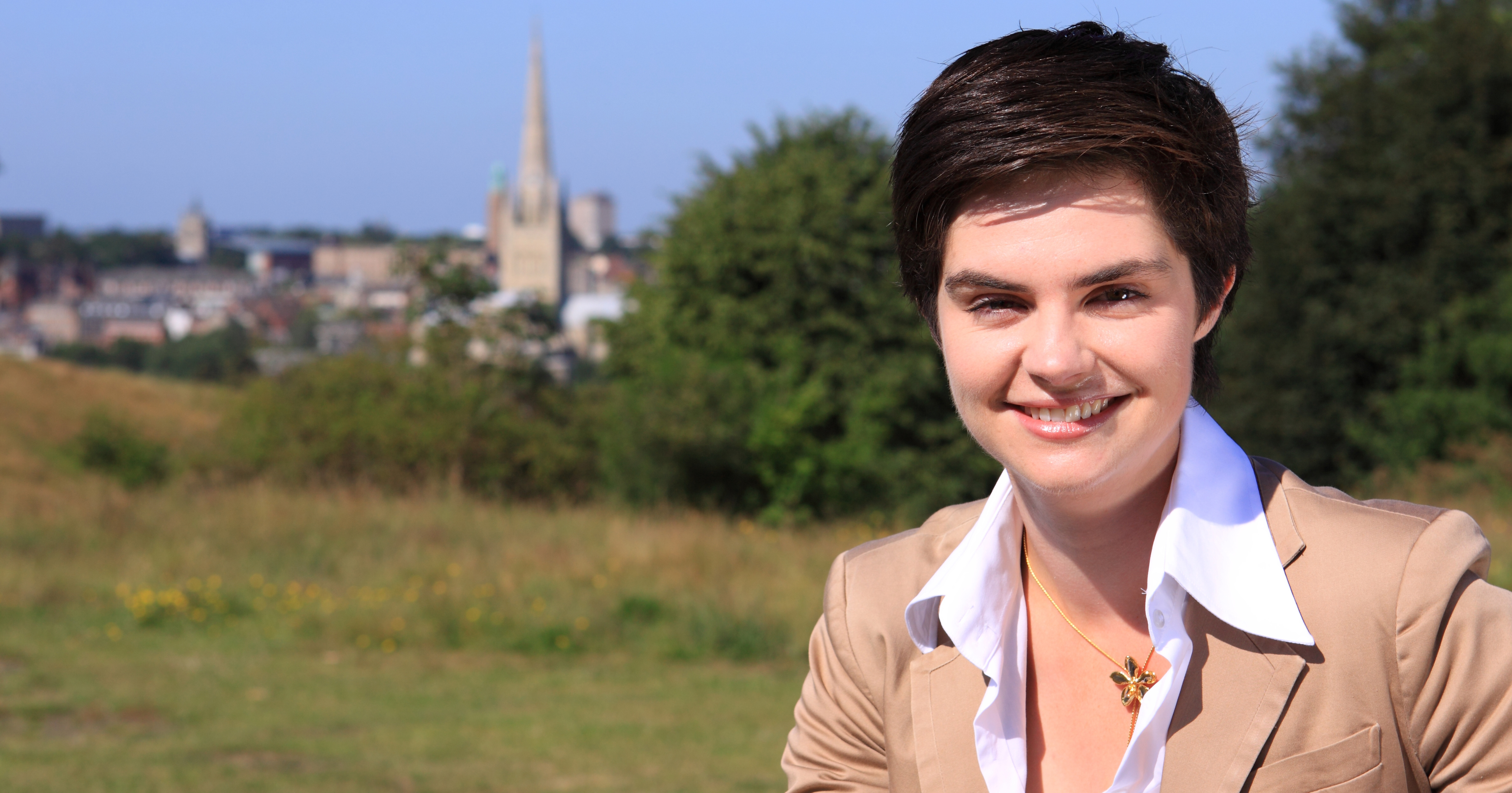 Politician Chloe Smith, who recently commented on same-sex marriage in Northern Ireland, smiling