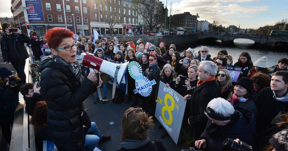 Volunteer Ailbhe Smyth is pictured speaking into a megaphone to a crowd at a protest for Repeal 8
