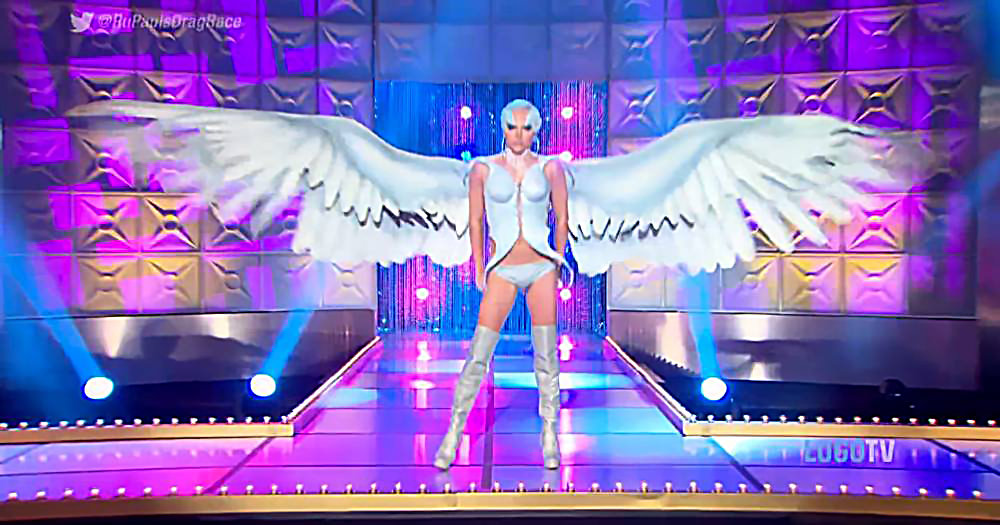 Drag queen Courtney Act in a costume with wings