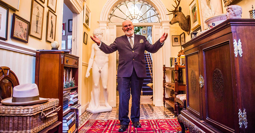 David Norris stands in his hallway of his georgian home