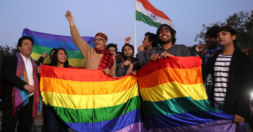 Indian LGBT people holding a pride flag protesting Section 377