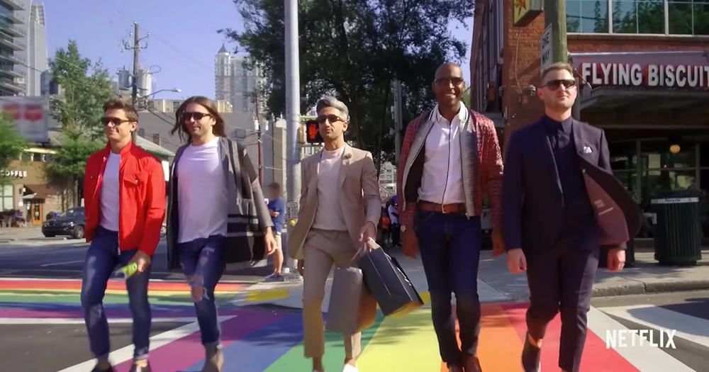 queer eye trailer, the five hosts are walking across a zebra crossing