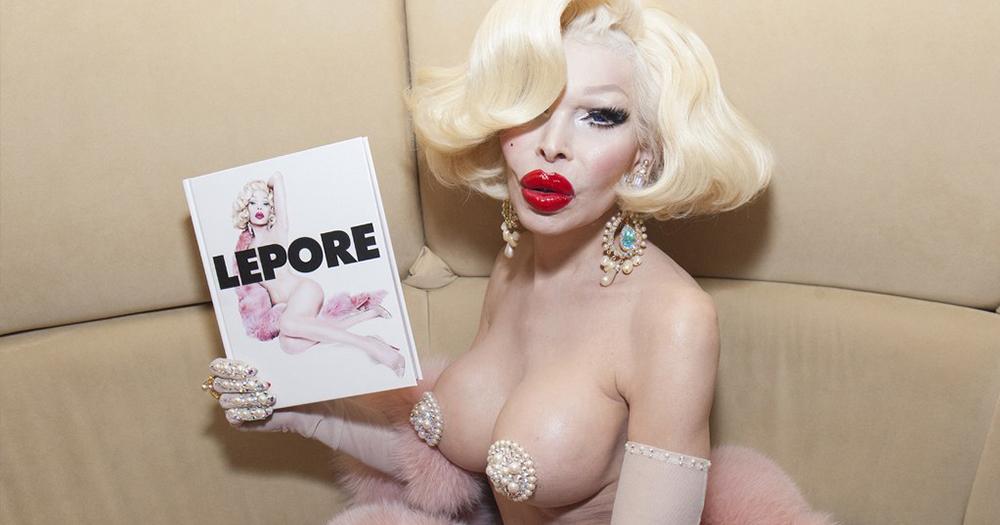 Amanda Lepore Holding her book entitled Lepore