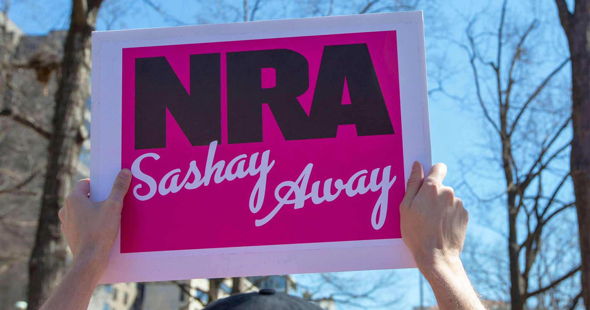March For Our Lives protester holding a sign that says 'NRA Sashay Away""
