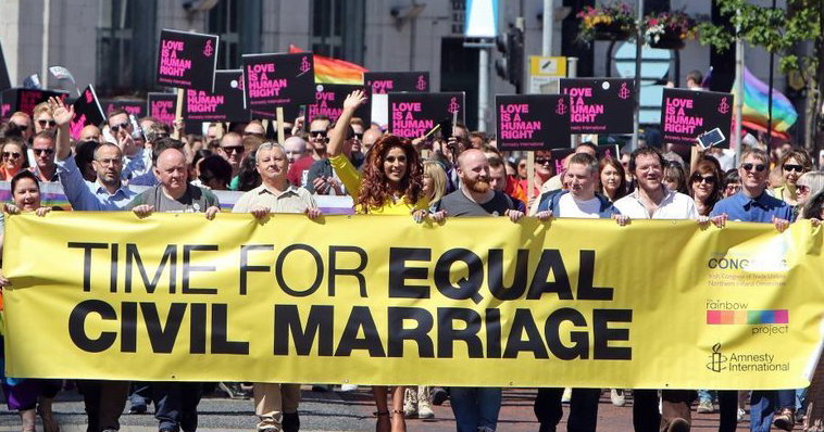 A group of protester marching for equal marriage, holding the sign 'time for equal civil marriage.' Sinn Féin president Mary Lou McDonald has now expressed support for marriage equality.