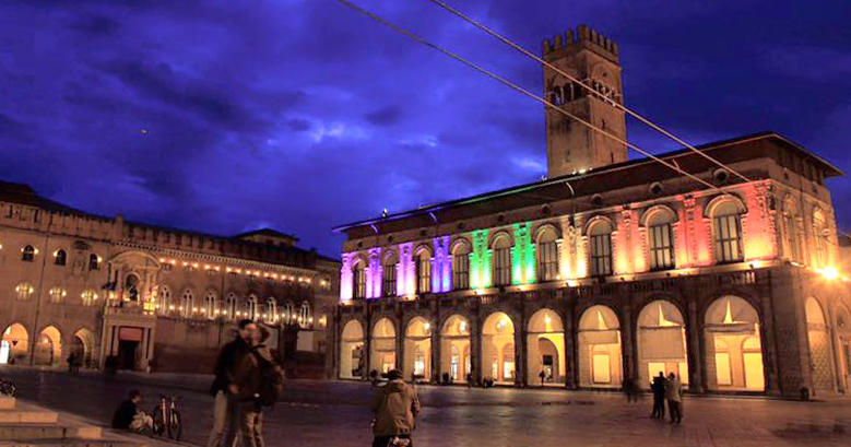 Palazzo del Podestà in Bologna lit up with rainbow colors