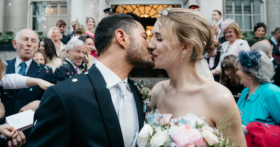 Photo of Hannah Winterbourne and Jake Graf kissing on their wedding day