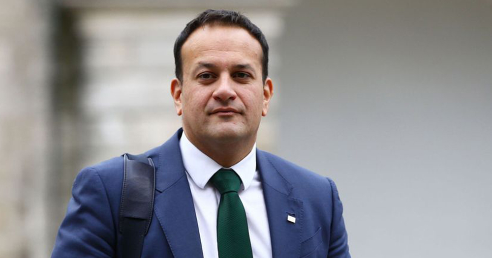 Varadkar pictured wearing a navy suit and green tie