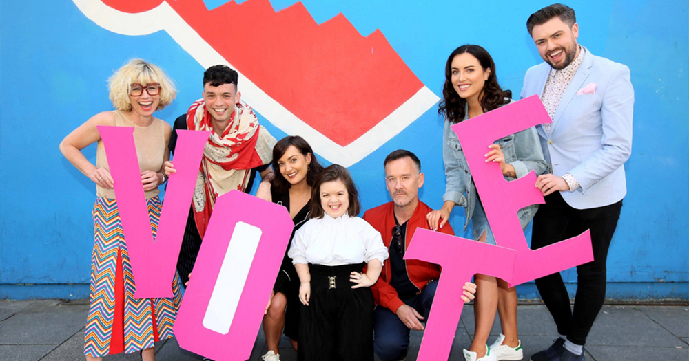 influencers stand outside Maser's repeal wall