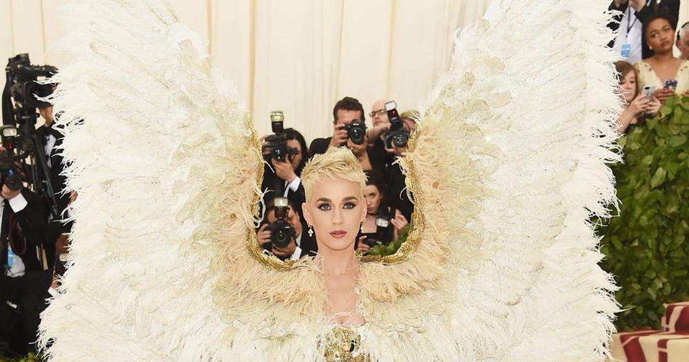 Katy Perry on the Met Gala red carpet wearing a huge set of wings