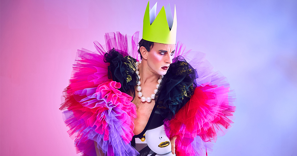 Drag queen Jonny Woo poses wearing a crown and a gown made of tulle