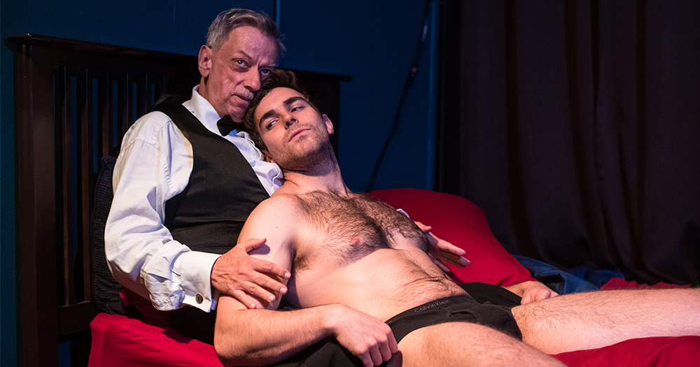 Young man in underwear sprawls in the arms of an older gentlemen