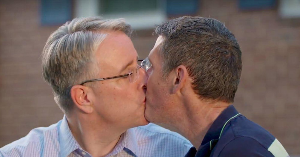 Democratic candidate Rich Madaleno kissing his husband Mark Hodge