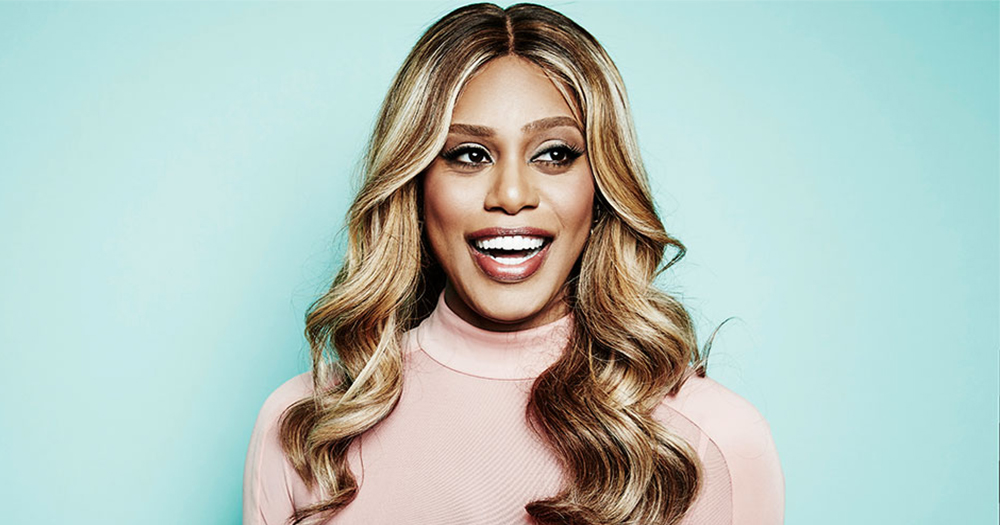 Laverne Cox, who will produce the documentary Trans Lives On Screen, standing against a pale blue background