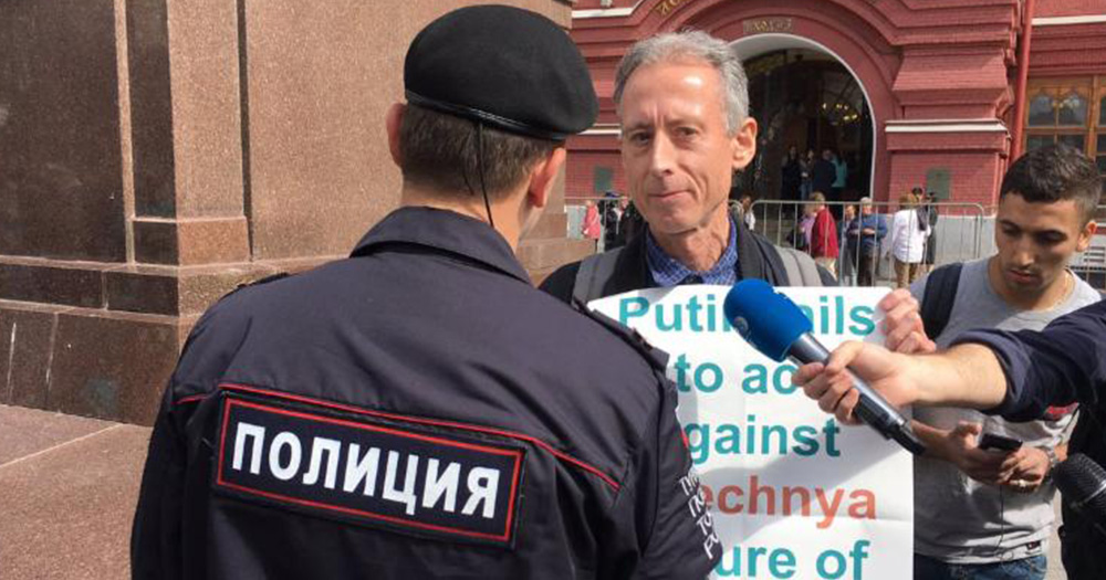 Tatchell being confronted by police in Russia