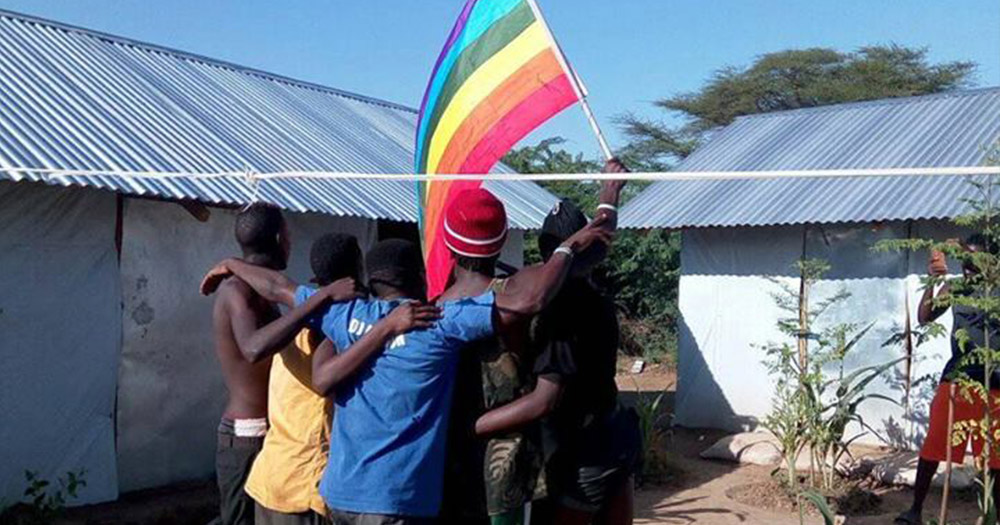 LGBT+ members pose for a photo with the pride flag in Kakuma refugee camp