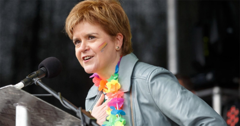 Nicola Sturgeon who oversaw the landmark law with a rainbow sign painted on her face