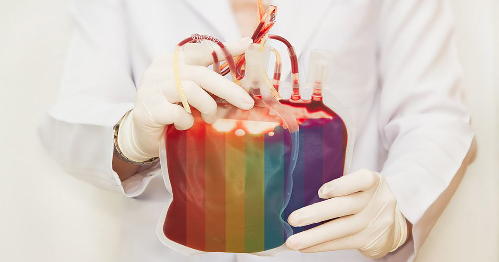 A doctor holds a bag of rainbow coloured blood ready to screen