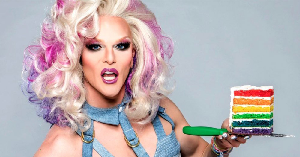 Drag queen Willam holds slice of cake with rainbow colours in its sponge