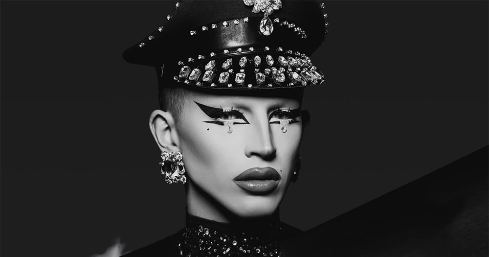 Black and white headshot of drag queen Aquaria who was booed off stage