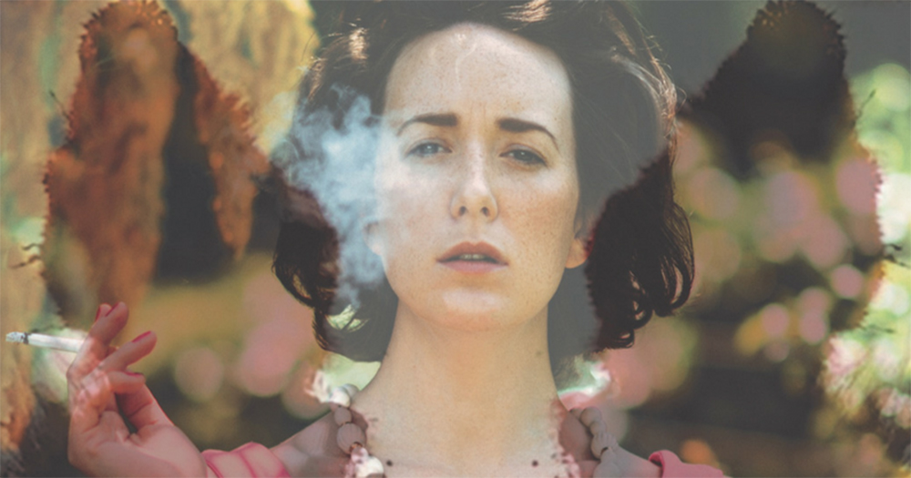 A poster for the show The Patient Gloria for Dublin Theatre Festival containing a woman in 1970's style clothes smoking while looking directly at the viewer