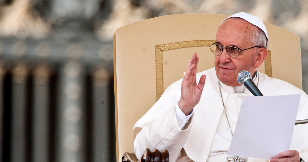 Pope is pictured sitting in a chair